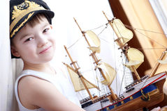 Captain. Portrait of the young boy with the model ship Royalty Free Stock Photography