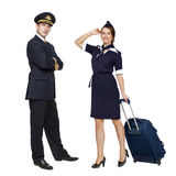 Captain of the aircraft and a beautiful flight attendant in a da Royalty Free Stock Photo