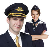 Captain of the aircraft and a beautiful flight attendant in a da Stock Photos