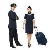 Captain of the aircraft and a beautiful flight attendant in a da Stock Images