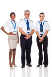 Captain airline crew. Portrait of senior captain with airline crew on white background stock photography