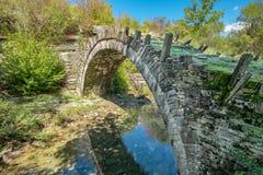 Captain Arkouda's bridge. Central Zagoria, Greece. One-arch stone bridge of Captain Arkouda on the river of Xiropotamos. Central Zagori. Epirus, Greece Royalty Free Stock Images