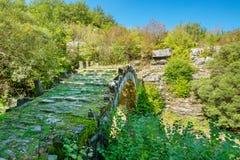 Captain Arkouda`s bridge. Central Zagoria, Greece. One-arch stone bridge of Captain Arkouda on the river of Xiropotamos. Central Zagori. Epirus, Greece Stock Photos