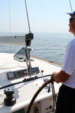 Captain beyond the yacht steering. Directing into the sea Royalty Free Stock Photos
