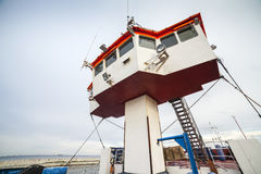 Captain bridge located on huge cargo ship Stock Photo