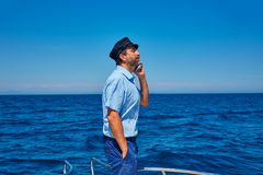 Captain cap sailor man talking mobile phone boat Royalty Free Stock Photos