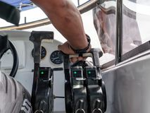 Captain control hand throttle on speedboat. Captain control hand throttle lever on speedboat Stock Photography