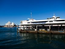 Captain cook cruises is an Australian cruise operator at circular quay wharf 6 with the view of Sydney Opera house. stock images