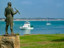 Captain Cook statue and view over the Endeavour River. Statue of Captain Cook looking towards the site where the Endeavour was beached after running aground on Stock Image