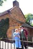 Captain Cooks Cottage. MELBOURNE, AUS - APR 14 2014:Couple wearing English costumes from the 17th century era at Captain Cooks Cottage.It's a popular tourist Royalty Free Stock Photo