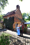 Captain Cooks Cottage. MELBOURNE, AUS - APR 14 2014:Couple wearing English costumes from the 17th century era at Captain Cooks Cottage.It's a popular tourist Stock Photography