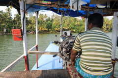 The captain crossing a river of the backwaters on a ferry Royalty Free Stock Images