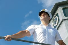 Captain on the gallery of navigation bridge of ship royalty free stock photography