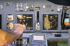 Captain hand accelerating on the throttle in flight simulator Stock Photo
