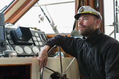 Captain at the helm of boat going along the Pacific Ocean Royalty Free Stock Photography