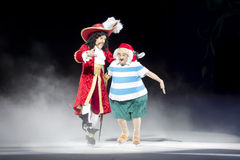 Captain Hook and Mr. Smee. GREEN BAY, WI - MARCH 10: Captain Hook and Mr. Smee on skates at the Disney on Ice Treasure Trove show at the Resch Center on March 10 Stock Photography
