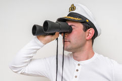 Captain looks through a binoculars Royalty Free Stock Photography