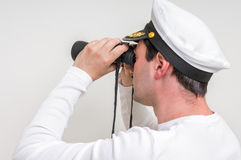 Captain looks through a binoculars Stock Images