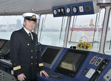 Captain of the ocean ship. Captain looking ahead on the navigation bridge of ocean ship Royalty Free Stock Photography