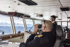 Free Captain Of Cruiser Glassing Out For Icebergs On Arctic Ocean Royalty Free Stock Photography - 58755487