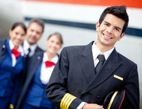 Captain pilot with cabin crew Stock Photos