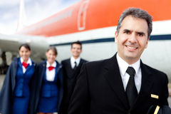 Captain pilot with cabin crew Royalty Free Stock Image
