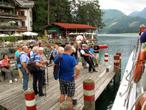 Captain pulling boat to jetty. Captain pullting the boat to the jetty during an excursion at lake Weissensee, Austria Stock Photos