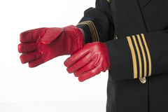 Captain putting on gloves Royalty Free Stock Photo