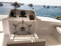 Captain`s cabin on a ship, boat, cruise liner with a steering wheel, dashboard, armchair, marine compass and instruments for cont royalty free stock photo