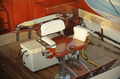 Captains chair. Chair on a yacht during sunset at a Marina in Southern Florida royalty free stock photography