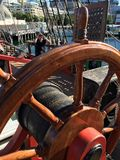 Captain's steering wheel on The Endeavour. Wooden steering wheel tall ship The Endeavour replica Captain James Cook Australia Royalty Free Stock Photo
