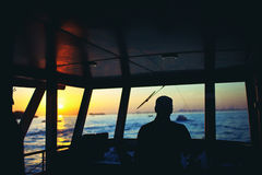 Captain. Of the ship at sunset royalty free stock images
