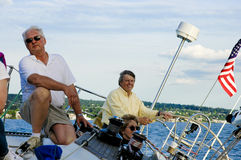 Captain and the Skipper. The captain and the skipper on the deck of the sailboat Stock Photo