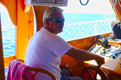 Captain of a small passenger boat Royalty Free Stock Images