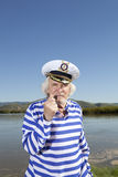 Captain smokes a pipe. Sailor man Royalty Free Stock Photos