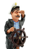 Captain with steering-wheel isolated Royalty Free Stock Photo