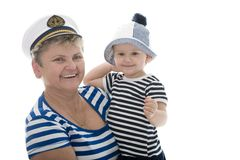 Captain woman in studio with baby Stock Photography
