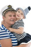 Captain woman in studio with baby Royalty Free Stock Photos