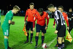 Captains Conor McCormack Cork City, Jason Conway St. Marys AFC and referee David Keeler look at the coin toss royalty free stock photography