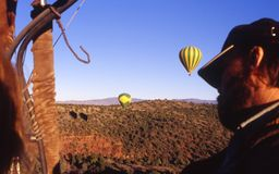Captains View. View from a hot air balloon with Captain of the balloon in foreground stock image