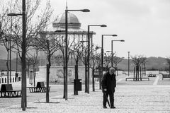 Square, the bandstand and the old man in Palmela, Setúbal, Portugal. Captation black and white in the city of Palmela, Setúbal, Portugal. An old man walks stock photo