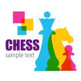 Caption - CHESS and colored chessmen. Royalty Free Stock Photos