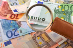 Caption EURO through a magnifying glass Stock Photos