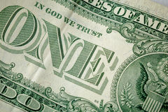 Caption: `one` and `in God we trust` on the one dollar bill. Cash, money. Close-up photo Stock Photo