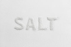 Caption salt from salt. Caption salt made from salt on a white background Stock Images