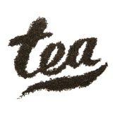 Caption tea by tea leaves. Caption tea by black tea leaves on white background royalty free stock photos