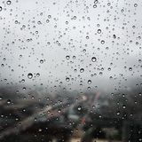 Water drops on the bedroom window. royalty free stock photography