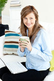 Captivating blond businesswoman holding a coffee Stock Photos