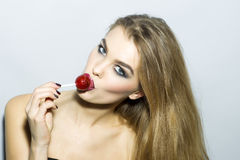 Captivating young blonde woman portrait with sugar candy Stock Photo