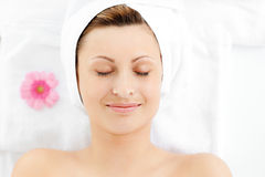 Captivating young woman resting on a massage table Stock Photography